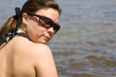 Woman at the beach in sun glasses Royalty Free Stock Photography