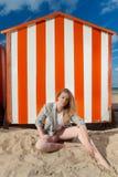 Woman beach sun sand hut, De Panne, Belgium stock photo