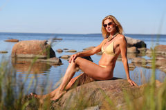 Woman on the beach. Woman sunbathing on the beach, summer time Royalty Free Stock Photography