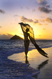 Woman on the beach at sunrise Royalty Free Stock Photography