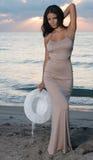 Woman on the beach at sunrise. Stock Photos