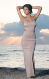 Woman on the beach at sunrise. Royalty Free Stock Photo