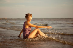 Woman on the beach at sunset. Royalty Free Stock Image