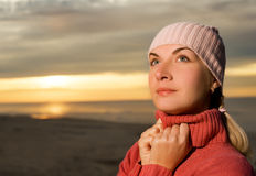 Woman on a beach at sunset Stock Image