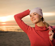 Woman on a beach at sunset Royalty Free Stock Photos