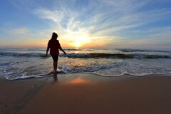 Woman on beach at sunset Royalty Free Stock Photo