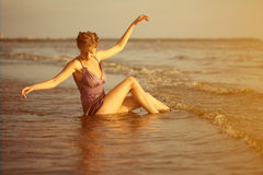 Woman on the beach at sunset. Royalty Free Stock Photo