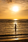 Woman on the beach at sunset in Guam. USA stock images