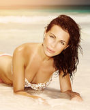 Woman on the beach in sunset light Royalty Free Stock Image