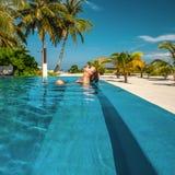 Woman at beach pool in Maldives. Woman at beach swimming pool in Maldives Royalty Free Stock Photos
