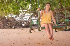 Woman in beach swing Royalty Free Stock Photo