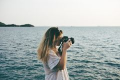 Woman on beach taking photos