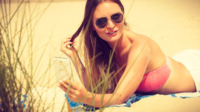 Woman on beach talking by mobile phone. Stock Photography