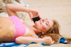 Woman on beach talking by mobile phone. Royalty Free Stock Photos