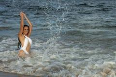 Woman with Beach Umbrella Royalty Free Stock Photo