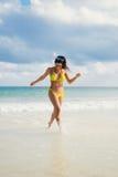Woman on beach vacation having fun Royalty Free Stock Photography