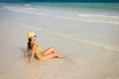 Woman on beach vacation sunbathing at seashore Royalty Free Stock Image