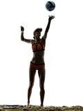 Woman beach volley ball player silhouette. One woman beach volley ball player silhouette in studio silhouette isolated on white background Stock Images