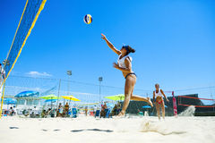 Woman beach volleyball player. Attack Stock Image