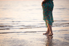 Woman on the beach. Walking barefoot. Sea, sunset, romance Stock Photography