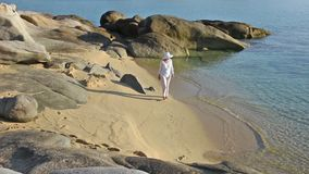 Woman on the beach stock footage