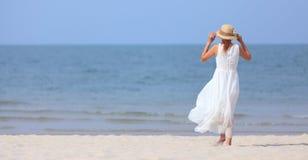 Woman on beach Stock Image
