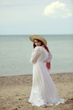 Woman at the beach wearing vintage dress Royalty Free Stock Photography