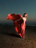 Woman on beach wind blowing fabric Royalty Free Stock Photography