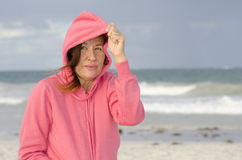 Woman at beach in windy autumn weather Royalty Free Stock Photo