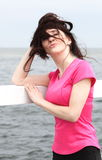 Woman on the beach, windy day Royalty Free Stock Image