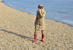 Woman on a Beach in Winter Stock Photos