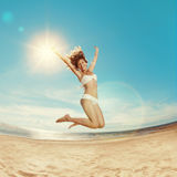 Woman on the beach. Young girl on the sand by sea. Stylish beaut Royalty Free Stock Photo