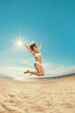 Woman on the beach. Young girl on the sand by sea. Stylish beaut Stock Photo