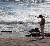 Woman beachcomb on Glass Beach Stock Photography