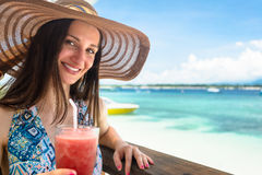 Woman in beachwear enjoying drink in beach cafe at sea royalty free stock photo
