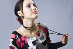 Woman with beads Stock Photos