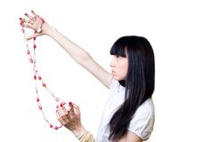 Woman with beads Stock Images