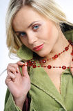 Woman with beads. Portrait of woman with beads Royalty Free Stock Images