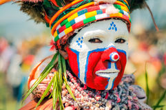 Woman with beads and headband in Papua New Guinea. Hagen show, Papua New Guinea - circa August 2015: Native woman with red, blue and white colour on her face and Royalty Free Stock Photography