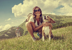 Woman with beagle on mountain hill Royalty Free Stock Photos