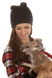 Woman in beanie and plaid shirt baby kangaroo look down Royalty Free Stock Photos