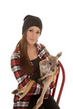 Woman in beanie and plaid shirt baby kangaroo look Royalty Free Stock Photography