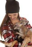 Woman in beanie and plaid shirt baby kangaroo Royalty Free Stock Images