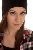 Woman in beanie and plaid shirt close look smile royalty free stock photo