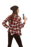 Woman in beanie and plaid shirt gun up side royalty free stock photo