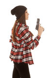Woman in beanie and plaid shirt stand side Stock Photo