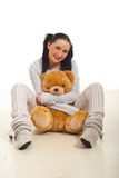 Woman with bear toy on floor royalty free stock photos
