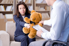 The woman with bear toy during psychologist visit Royalty Free Stock Photos