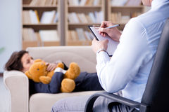 The woman with bear toy during psychologist visit Stock Photo