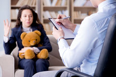 The woman with bear toy during psychologist visit Stock Photography